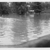 Image of 1940 Flood - Elkin.  1940 flood.  West Main and Standard Streets looking north over the Big Elkin Creek.