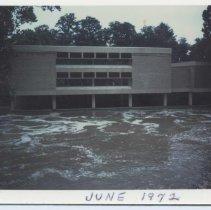 Image of 1972 Flood - Elkin.  Elkin Public Librry during 1972 flood.  Big Elkin Creek is in foreground.