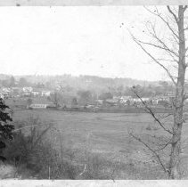 """Image of Elkin, from Jonesville - Elkin.  View of the old railroad bridge.  Note on the back of the picture reads, """"1888 I think.  On 1890 the first train passed over the new road.""""  A further note says, """"Possibly comment by Mrs. R. L. Hubbard or Mrs. G. T. Roth.""""  Picture donated by Elizabeth Hubbard Harris."""