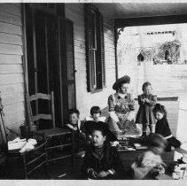 Image of Roth Children - Elkin.  Roth children gathered on porch, ca. 1906-1908.  The children, as identified by Elizabeth Harris, are: Marjorie Irene Roth, William Theodore Roth, Louisa Mosser Roth, Gilvin Theodore Roth, Emily Elizabeth Hubbard, Catherine Roth Hubbard, Joe Mosser or Andrew Keck, Ruth Mosser or Betty Keck