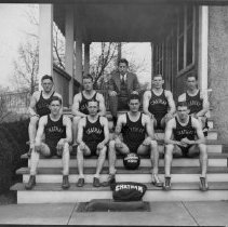 Image of Chatham Basketball Team - Elkin.  Chatham Basketball Team, City Champions 1930-31.  Their coach, Mr. Raymond Harris, in suit, is sitting at the top of the stairs.