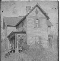 "Image of Thomas Lenoir Gwyn House - Elkin.  Home of Thomas Lenoir Gwyn, built after he left ""Cedar Point"" around 1885.  Note on the back reads, ""Miss Sallie Gwyn on horse, Grandma and Grandpa on porch, Papa on back porch.""  The house was located on Business 268 where the Presbyterian Church is now.  Picture is from the Ohna Bivins Collection."