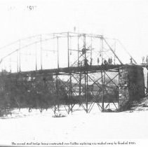 """Image of Construction of Bridge - Elkin.  Second steel bridge being constructed over the Yadkin River, replacing one washed away by the flood of 1916.  Several men can be seen at work on the structure.  Picture is part of a calendar titled """"Memories of Days Gone By."""""""