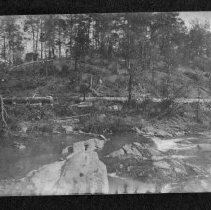 """Image of Carter's Falls - Elkin.  Carter's Falls, showing the flume carrying water to the new electric plant, ca. 1915.  A note on the back of the picture refers to it as """"Carter's Mill"""", and Claire Smith says it is probably the original site of Jolly Mill."""