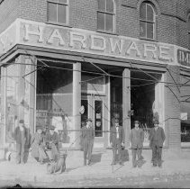 Image of McNeer's Hardware - Elkin.  Post card of McNeer's Hardware, Main and Bridge Streets, ca. 1917.  A number of men are standing along the street outside the building.