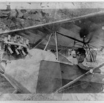 Image of Elkin's First  Airplane - Elkin.  Ted Brown seated in Elkin's first airplane, which was constructed by Ted and Jake Brown in the early 1930s.  It was a one-passenger Heath-Parasol airplane.
