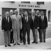 Image of Elkin Town Officials 1989 - Elkin Town Officials, 1989.  Left to right: Avery Watson, Commissioner; Lewis Alexander, Town Attorney; Bill Smith, Commissioner; Ed Burchins, Town Manager; Joe Harris, Commissioner; Tom Gwyn, Mayor; Fred Eidson, Commissioner; Jack Moore, Commissioner.