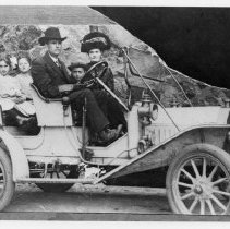 Image of Whitaker Family. - Elkin. Mr. W. W. Whitaker and family in car. Early 1900's. There are four children. Three little girls are in the back seat. A small boy is in front between his parents.