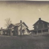 Image of Circle Court, Elkin - Elkin.  Circle Court, Elkin, ca. 1923.  The house on the left was built by R. R. Gwyn ca. 1855.