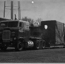 Image of Chtaham Truck with Fiberwoven Loom - Elkin.  Chatham truck transporting a fiberwoven loom for Aabe Company (a Dutch Company) ca. 1965.