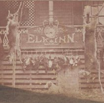Image of After the Hunt - Elkin.  Charles Gwyn (on right), proprietor of Elk Inn, with Rich Chatham after hunt, ca. 1890.  They are displaying two deer and a variety of game birds.  The Elk Inn was located on the west corner of Church Street and Main Street.