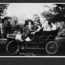 "Image of Roth Family - Elkin.  Roth family in Touring Car, May 1908.  Caption at bottom of picture reads, ""Quite a Load.""  Those in the car, as identified on the back of the picture are: Joe Mosser, William Theodore Roth, John Shimer Roth, Gilvin Theodore Roth, Louisa Mosser Roth, Ruth Mosser, Aunt Flora Mosser, Aunt Rosa Mosser Roth, Thomas Mosser Roth.  A note also say the picture was taken by Uncle Charlie Mosser of Allentown, Pa."