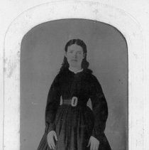 Image of Martha Hollingwsorth - Martha Hollingsworth, born March 25, 1835.  This picture was taken when she was a young woman.  She is wearing a long-sleeved dress with full skirt and wide belt.
