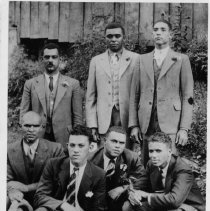 Image of Young Black Men - This is a 1936 photograph of Black men who grew up in this community. Standing left to right: Earl Dobson, Sam France and Jesse Dyson. Kneeling: Herman Anderson, Joe Hollie Tucker James Boston Tucker and Jesse David Tucker. The Tucker men are sons of Charlie and Ollie Grogan Tucker.