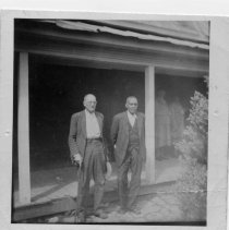 Image of Sam Seal and Charlie Tucker - This is a picture of Sam Seal (left) and Charlie Tucker (right). standing in the front yard of Charlie Tucker's home. It was May 1 in the year 1947 or 1948.  It was Charlie Tucker's birthday and Sam Seal made a visit to wish him a happy birthday.