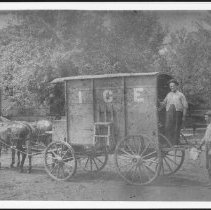 Image of William H. Burkhart and his ice wagon