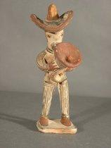 Image of man w instument, figurine