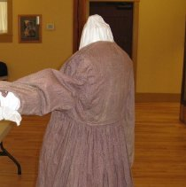 Image of Preparing the dress for display