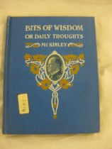 """Image of The book is titled """"Bits of Wisdom William McKinley."""" The book is blue with white lettering. The graphics on the cover feature yellow flowers in a decorative pattern around an oval portrait of McKinley. The book contains useful sayings and parts of speeches of William McKinley. Inside the front of the book, the name Chas. Dick is written and also the stamp of George Bechtel. Has a blue ribbon bookmark. - Book"""
