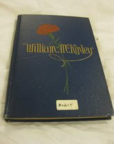 """Image of The book is titled """"The Life of William McKinley: Twenty-Fifth President of the United States."""" The book was written by Jane Elliott Snow. It is dark blue with gold lettering. The graphics on the cover feature a scarlet carnation. The book is a biography of William McKinley. Limited edition #884. - Book"""