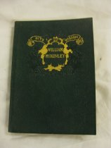 """Image of The book is titled """"Bits of Wisdom William McKinley."""" The book is green with gold lettering. The graphics feature a scroll banner and a fruit wreath embossed on the cover. The book contains useful sayings and parts of speeches of William McKinley. Inside the front of the book, the name William Parker is written with the date June 23, 1908 and the words, """"Read often."""" - Book"""