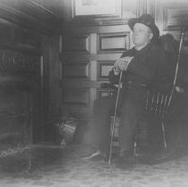 Image of Sam Jones Seated by a Fireplace at Miramar - undated