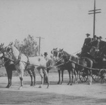 Image of Gentlemen on a Horse-Drawn Carriage - undated