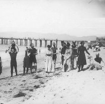 Image of Jones Family, including Marion and Georgina Jones, at the Beach near Pier - 1900