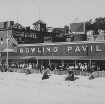 Image of Crowd on Beach Boardwalk near Bowling Pavilion and North Beach Bath House - undated
