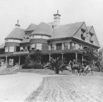 Image of Miramar, home of John P. Jones, with Family in Horse-Drawn Carriage - undated