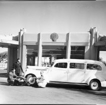 Image of Reyes Ambulance at Shell Gas Station - 1940s