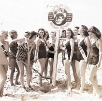 Image of Beauty Contestants Posing at a Route 66 Sign, Santa Monica Beach - 1958