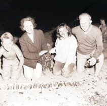 Image of Governor Warren and Family with Grunion Catch - 1946/07/06