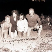 Image of Governor Warren and Family with Grunion Catch, Santa Monica Bay - 1947/07/06