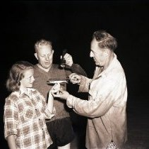 Image of Governor Earl Warren and Daughter, Grunion Catch in Santa Monica Bay - 1946/07/01