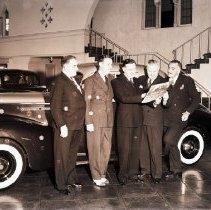 Image of Simonson-Schatmayer-Packard Car Dealership Salesmen, 1940 - 1940/09/23