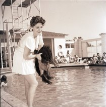 Image of Model with Dog at Hotel Miramar Pool, 1941 - 1941/05/17