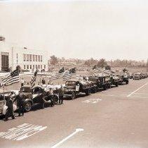 Image of Scrap Metal Drive Trucks Depart City Hall, 1941 - 1941/07/30