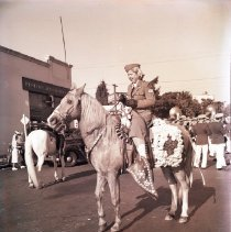 Image of Antoinette Carrillo Rides in a Parade, 1942 - 1942/11/21