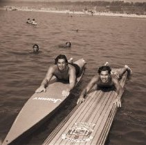 Image of Johnny Weissmuller and Man on Paddleboards, 1944 - 1944/07/01