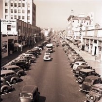 Image of Parked Cars and Businesses on 4th Street, 1940 - 1940/10/12