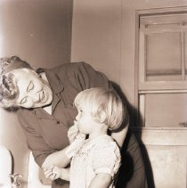 Image of Woman Assists Child at Day Nursery, 1942 - 1942/10/09