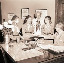 Image of Girl Scouts Receive Commemorative Stamps from Postmaster, 1948 - 1948/11/02