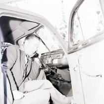 Image of Emerson Gaze Uses Radio-Phone, 1947 - 1947/03/25