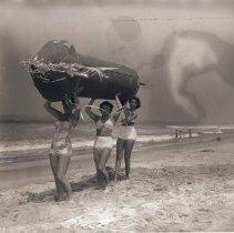 Image of Women Carry Oversize Firecracker, 1952 - 1952/07/01