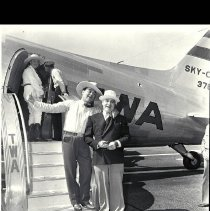 Image of Leo Carrillo Departing on a TWA Airplane, 1938 before take-off from airport, August 14, 1938. Leo Carrillo and Will Rogers before Departure on a TWA Airplane before take-off from airport, August 14, 1938.  - 1938/08/14
