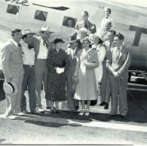 Image of Betty Rogers and Others Departing on a TWA Airplane airport, August 14, 1938. Mrs Rogers, Leo Carillo and Others Before Departure on a TWA Airplane  - 1938/08/14