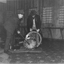 Image of Police Destroy Roulette Wheel During Raid on the Rex Gambling Ship, 1939 - 1939/11/21