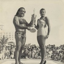 Image of Wrestler Baron Michele Leone at the Miss Muscle Beach Championship - 1952/01/01-1952/12/31