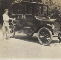 Image of A Woman Beside a Model T Ford Automobile - circa 1920